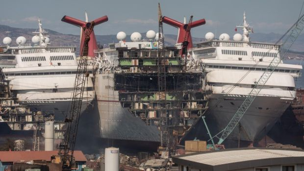 Luxury cruise ships are seen being broken down for scrap metal. Photograph: Chris McGrath/Getty
