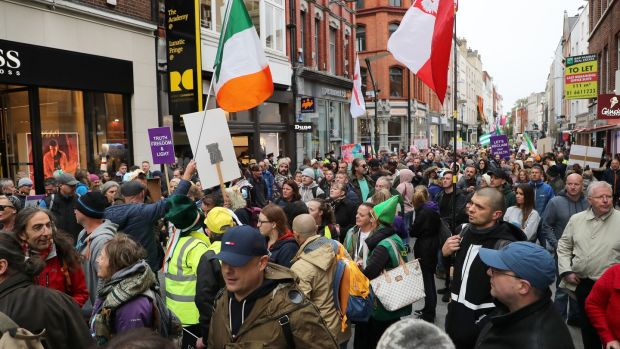 Anti-mask campaigners hold sit-down protest on Grafton Street