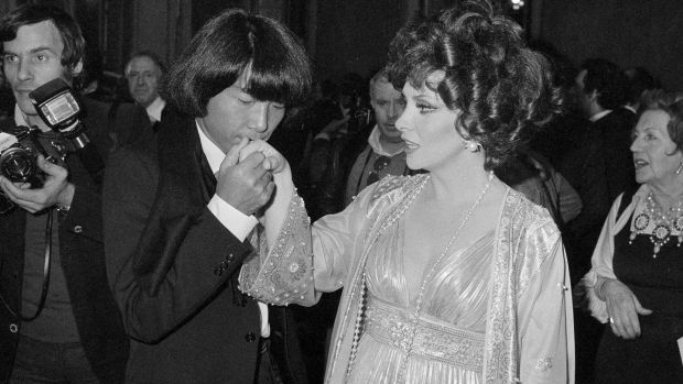 Kenzo Takada kisses the hand of Italian actress Gina Lollobrigida after she awarded him as one of the 10 most elegant men in the world in Rome, Italy in December 1977. Photograph: AP