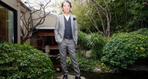Japanese fashion designer Kenzo Takada outside his Paris home in 2009.  Photograph: AP