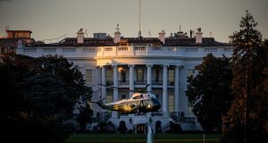 President Donald Trump leaves the White House on Marine One, heading for Walter Reed Medical Center after testing positive with the coronavirus, Oct. 2, 2020.(Damon Winter/The New York Times)