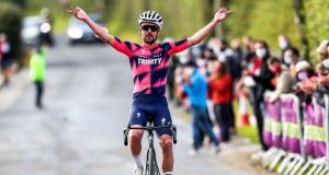 Ben Healy of Trinity Racing celebrates after winning  the Irish National Road Race Championships in Newcastle West, Co Limerick on Saturday. Photograph: Bryan Keane/Inpho