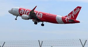 An Air Asia A320-200 plane pictured taking off from Kuala Lumpur International Airport 2 in Sepang, Malaysia. Photograph: AP Photo/Joshua Paul