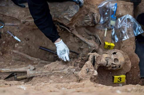 RECLAIMING THE PAST:  Close-up view of human remains found during exhumation works at the Civil Cemetery, in Guadalajara, central Spain, on Monday. The works are being carried out by the Spanish Association for the Retrieval of Historic Memory. Photograph: Nacho Izquierdo/EPA