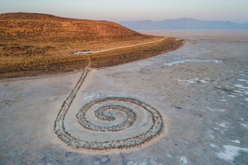 SALT LAKE DROUGHT: Robert Smithson's 1,500ft earthwork, Spiral Jetty, on the shore of Great Salt Lake, Utah. Constructed in 1970, the work remained submerged until 2002, when a mega-drought began to afflict the region. Above average temperatures and water diversion for agriculture and drinking water are also to blame for lowering water levels. EPA Photograph: Jim Lo Scalzo/EPA