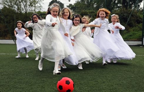 HAVING A BALL: Girls attending St Brigid's National School, Killygarry, Co Cavan, wear their First Holy Communion dresses to school following their delayed special day, held on Saturday, which was caused by the national Covid-19 lockdown in May. Photograph: Lorraine Teevan