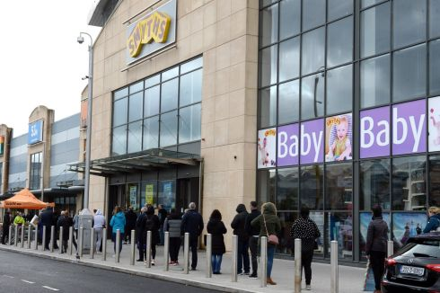 AN EYE ON CHRISTMAS: A queue forms outside Smyths toy store in Carrickmines, Dublin, as numbers allowed in simultaneously remain limited due to Covid-19. Photograph: Dara Mac Dónaill