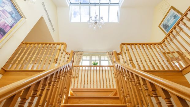 The property features a striking custom oak staircase