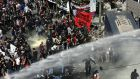 Clashes between riot police and protesters after the Golden Dawn trial verdict was announced in Athens. Photograph: Orestis Panagiotou/EPA