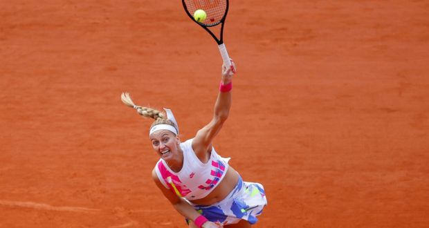Petra Kvitova serves  to  Laura Siegemund during their women's singles quarter-final at the  French Open. Photograph: Thomas Samson/AFP via Getty Images