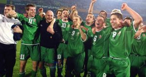 Ireland players celebrate after qualifying for the 2002 World Cup after their playoff against Iran in Tehran. Photograph:  Atta Kenare/AFP via Getty Images