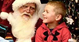 Sitting on Santa's knee  will be out this year for so many obvious reasons. Photograph: iStock