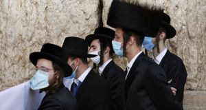 Ultra-Orthodox Jewish worshippers pray during the Sukkot festival, or the feast of the Tabernacles, at the Western Wall in the old city of Jerusalem, on Wednesday.  Photograph:  Menahem Kahana/AFP via Getty Images)