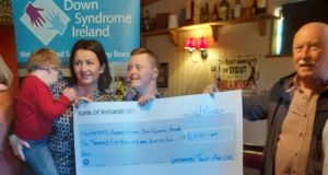 Club chairman Willie Hanrahan (right) presenting a cheque to Down Syndrome Waterford Branch for €2,575, proceeds from a Waterford Trout Anglers' competition