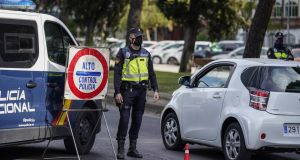 Police officers patrol a roadside checkpoint in Madrid on Thursday. Photograph: Paul Hanna/Bloomberg