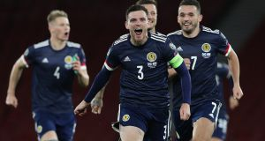 Andy Robertson celebrates after Scotland's victory over Israel in a penalty shoot-out in the semi-finals of the  Uefa Euro 2020 playoffs. Photograph: Ian MacNicol/Getty Images