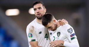 Ireland's Shane Duffy dejected with Matt Doherty after the Euro 2020 playoff defeat to Slovakia. Photo: Tommy Dickson/Inpho