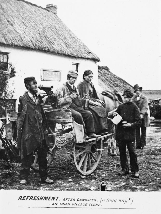 Drinkers featured in 'an Irish village scene', dated between 1890 and 1910. Photograph: National Library of Ireland/ Flickr Commons