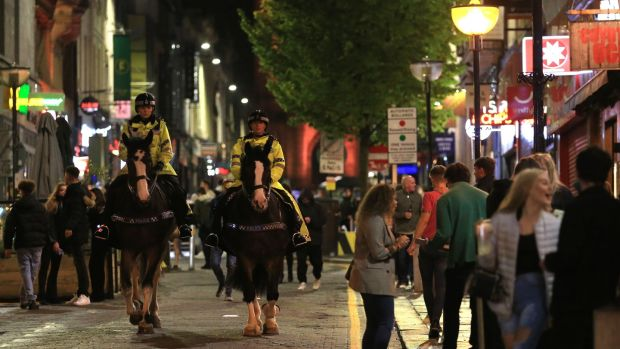Police patrol as revellers enjoy a night out in the centre of Liverpool, north west England on Saturday. Photograph: Lindsey Parnaby /AFP/ Getty Images)