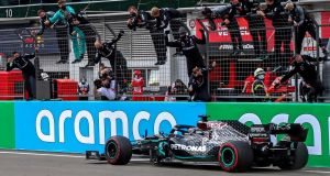 Formula One driver Lewis Hamilton and his Mercedes team celebrate winning the Formula One Eifel Grand Prix. Photograph: EPA
