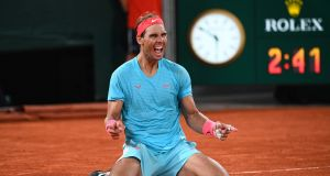 Rafael Nadal celebrates winning his 20th grand slam on Sunday at Roland Garros. Photograph: Getty Images