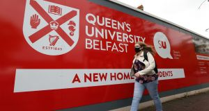 A student outside Queen's University Belfast. Photograph: Liam McBurney/PA Wire
