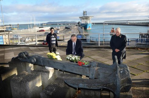 RMS LEINSTER: Richard Cruise, chairman (centre) with David Cotter, treasurer and Joe Ryan, secretary (right) members of the RMS Leinster Memorial Committee, laying a wreath at the anchor in Dun Laoghaire, Co Dublin. on the 102nd anniversary of the sinking of RMS Leinster. Photograph: Dara Mac Dónaill / The Irish Times
