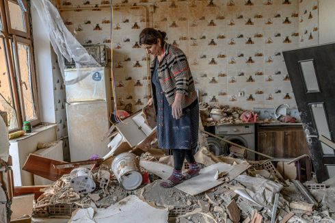 CONFLICT: Xatire Celilova walks in the kitchen of her destroyed flat following a ceasefire during a military conflict between Armenia and Azerbaijan over the breakaway region of Nagorno-Karabakh, in the town of Terter, Azerbaijan, on October 10th. Armenia and Azerbaijan traded accusations of new attacks on October 10th in breach of a ceasefire deal to end nearly two weeks of heavy fighting over the disputed Nagorno-Karabakh region. Photograph: Bulent Kilic/AFP via Getty
