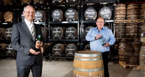 Invest Northern Ireland chief executive Kevin Holland  with Shane Braniff, owner of Echlinville Distillery