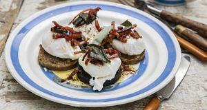 Poached eggs, black and white pudding, sage brown butter. Photograph: Harry Weir