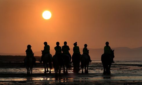 RIDERS ON THE STRAND: Horseriders and their mounts on Downhill beach in Co Derry as the autumnal sun dips towards the hills of Donegal. Photograph: Margaret McLaughlin