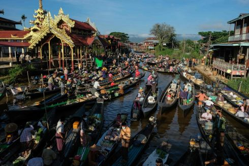 POP-UP MARKET: People buy goods from vendors at a floating market held on boats at Inle Lake in Myanmar's Shan State. Photograph: Wai Min Phyoe/AFP/Getty