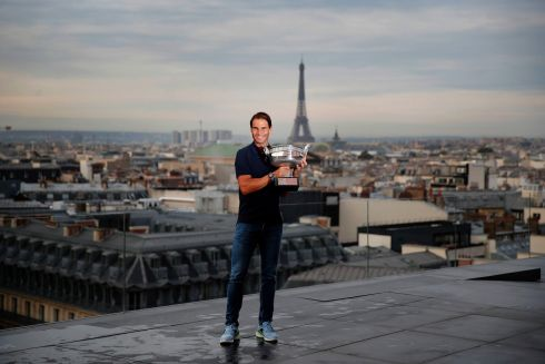 ONCE MORE WITH FEELING: Spanish tennis ace Rafael Nadal poses with his trophy during a photocall on the rooftop of Galeries Lafayette, Paris, after winning the final of the French Open tournament against Serbia's Novak Djokovic at the Roland Garros stadium. Photograph: Francois Mori/AP Photo