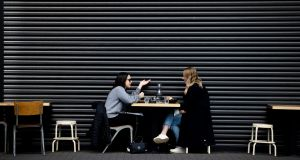 People  eating outdoors in Phibsborough, Dublin. Photograph: Tom Honan