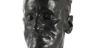 Joyce death mask, historic medals and books at eclectic Mullens Halloween sale