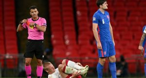 Harry Maguire is shown a red card in the first half against Denmark. Photograph: Daniel Leal Olivas/PA