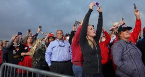 Supporters take pictures as Donald Trump arrives for a rally at Des Moines International Airport  in Iowa. Photograph: Scott Olson/Getty Images