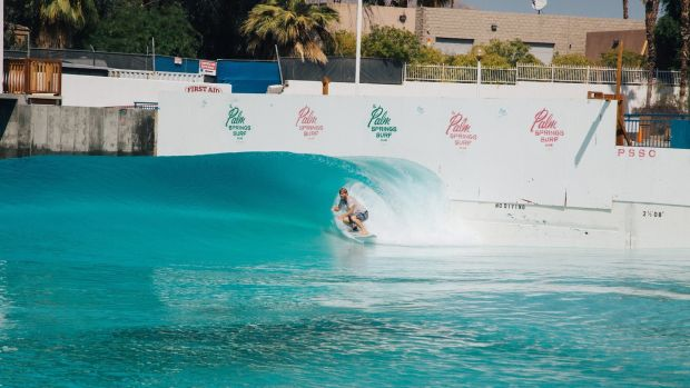 A surfer tries out the wave pool, developed by Tom Lochtefeld. Photograph: Akasha Rabut/NYT