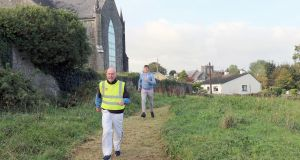 Running in the Aughrim Climate Action Park are Fr Gerard Geraghty (front) Rev John Godfrey. Photograph: Gerry Stronge
