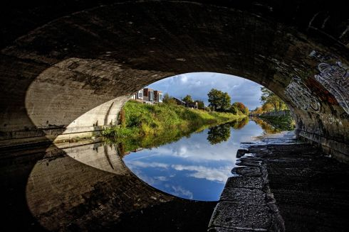 SALLY'S BRIDGE: The Grand Canal as seen from Parnell Bridge in Crumlin, named after John Parnell, great-great-grandfather of Charles Stewart Parnell, a director of the Grand Canal Company. It is popularly known as Sally's Bridge. It is a single-arch limestone bridge carrying road over Grand Canal, dated 1791. Photograph: Marc O'Sullivan