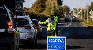 Members of An Garda at a checkpoint on the R173 in Co. Louth at the Loughanmore area close to Carlingford. The Garda have set up 132 checkpoints as part of Operation Fanacht, which is aimed at encouraging the public to adhere to health guidelines. Liam McBurney/PA Wire