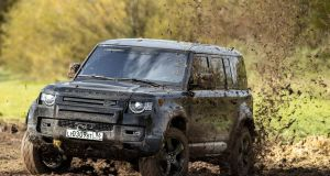 "The Land Rover Defender: ""Finished on the stunt course, I plod back to base. I think I've covered myself more in mud than glory, and Commander Bond remains elusively un-caught."""