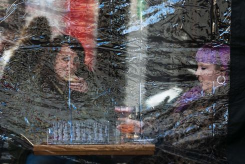 People on Quay Street in Galway, as seen through a clear PVC window on an outside Gazebo. Photograph: Andy Newman