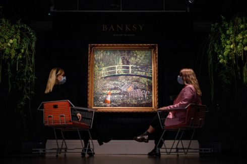 Show me the Monet by British street artist Banksy, on view as part of the contemporary art auction, at Sotheby's in London. Photograph: Tolga Akmen/AFP via Getty Images