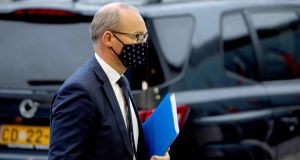 A masked Minister for Foreign Affairs Simon Coveney pictured arriving for a meeting of EU General Affairs ministers at the European Council building in Luxembourg earlier this week. Photograph: Virginia Mayo/AFP via Getty Images