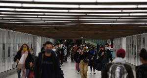Pedestrians wearing protective face mask pass along a passageway at Brussels Central railway station in Brussels on Friday. Photograph: Bloomberg