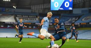 Sergio Agüero of Manchester City attempts to shoot under pressure from Gabriel of Arsenal during the Premier League match at the Etihad Stadium. Photo: Michael Regan/Getty Images
