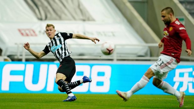 The ball deflects off Luke Shaw to put Newcastle ahead. Photo: Owen Humphreys/PA Wire