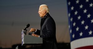 Democratic presidential candidate former Vice President Joe Biden speaks at Michigan State Fairgrounds on Friday.  Photograph: Carolyn Kaster/AP.