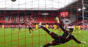 Billy Sharp equalises for Sheffield United from the penalty spot. Photograph: Gareth Copley/Getty/AFP